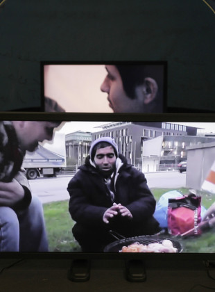 Immigrant BVirds & Welcome to Finland installation at Taidehalli, two monitors